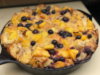 Skillet Peach & Blueberry Bourbon Bread Pudding